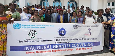 The Women's Platform of the Peace, Security & Cooperation Framework Inaugural Grantee Convening. Group holding banner.