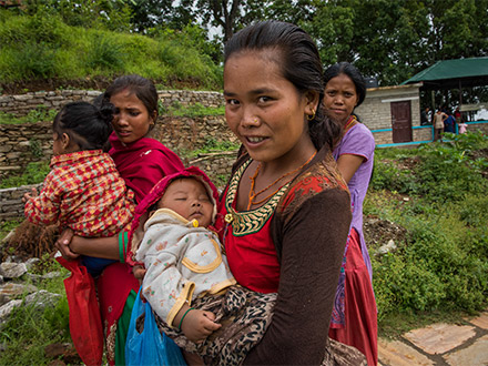 Nepali women with their children after the earthquakes