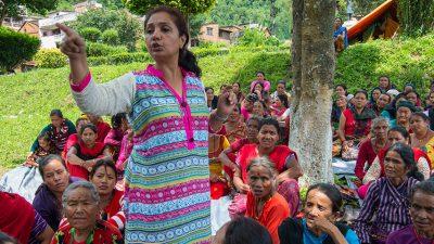 Yelisha Sharma, Communications Director for Tewa, speaks to women who are earthquake survivors in Nepal