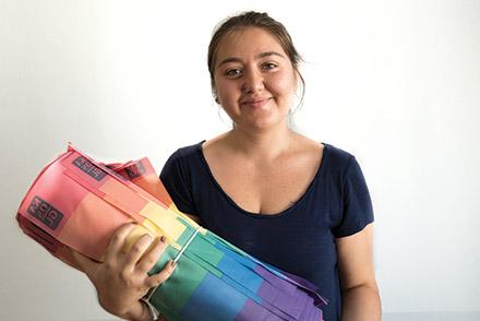 Gozde holding a rainbow flag